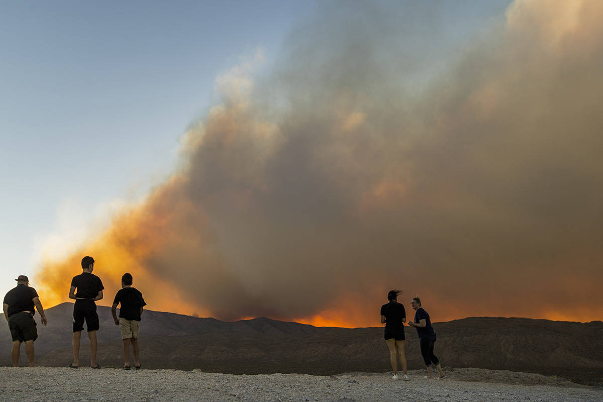 Onlookers stop to view the Mahogany Fire on Mount Charleston near a rise about Harris Spring Ro ...
