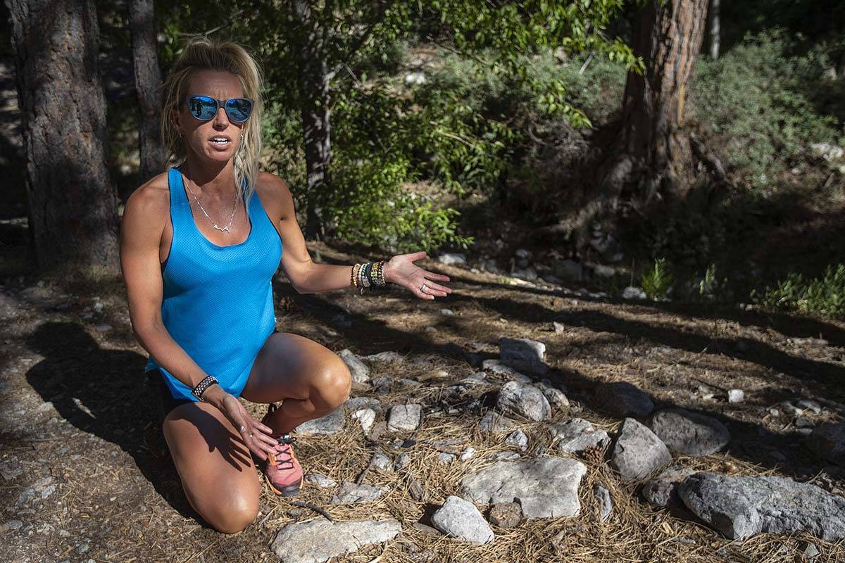 Stephanie Ibasco points out an illegal fire pit on a trail at Mount Charleston on Tuesday, July ...
