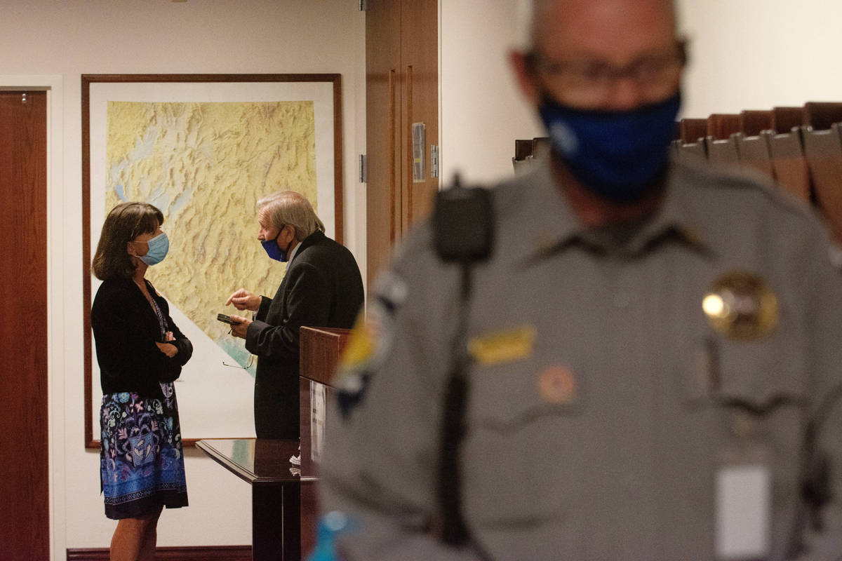 A Nevada Assemblywoman Robin Titus speaks with Assemblyman John Ellison during a recess on the ...