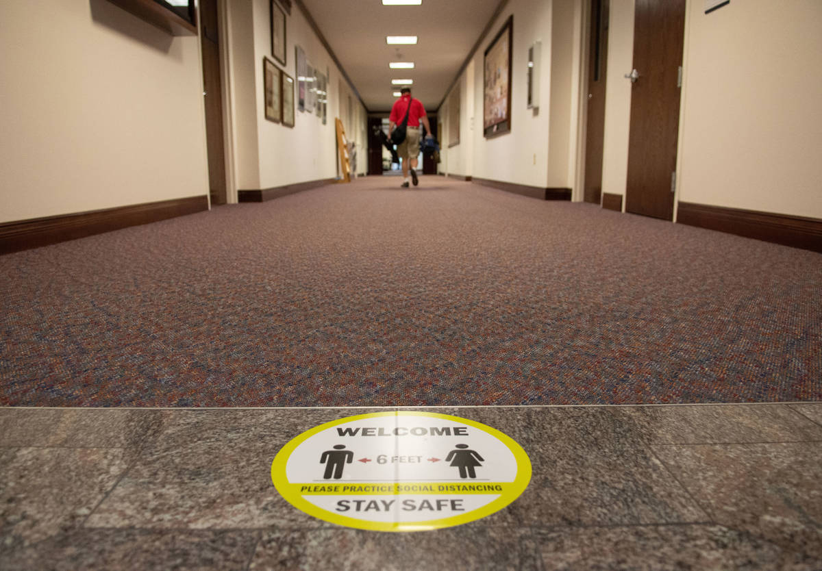 COVID-19 related safety protocol signage inside the Nevada Legislature on the second day of the ...