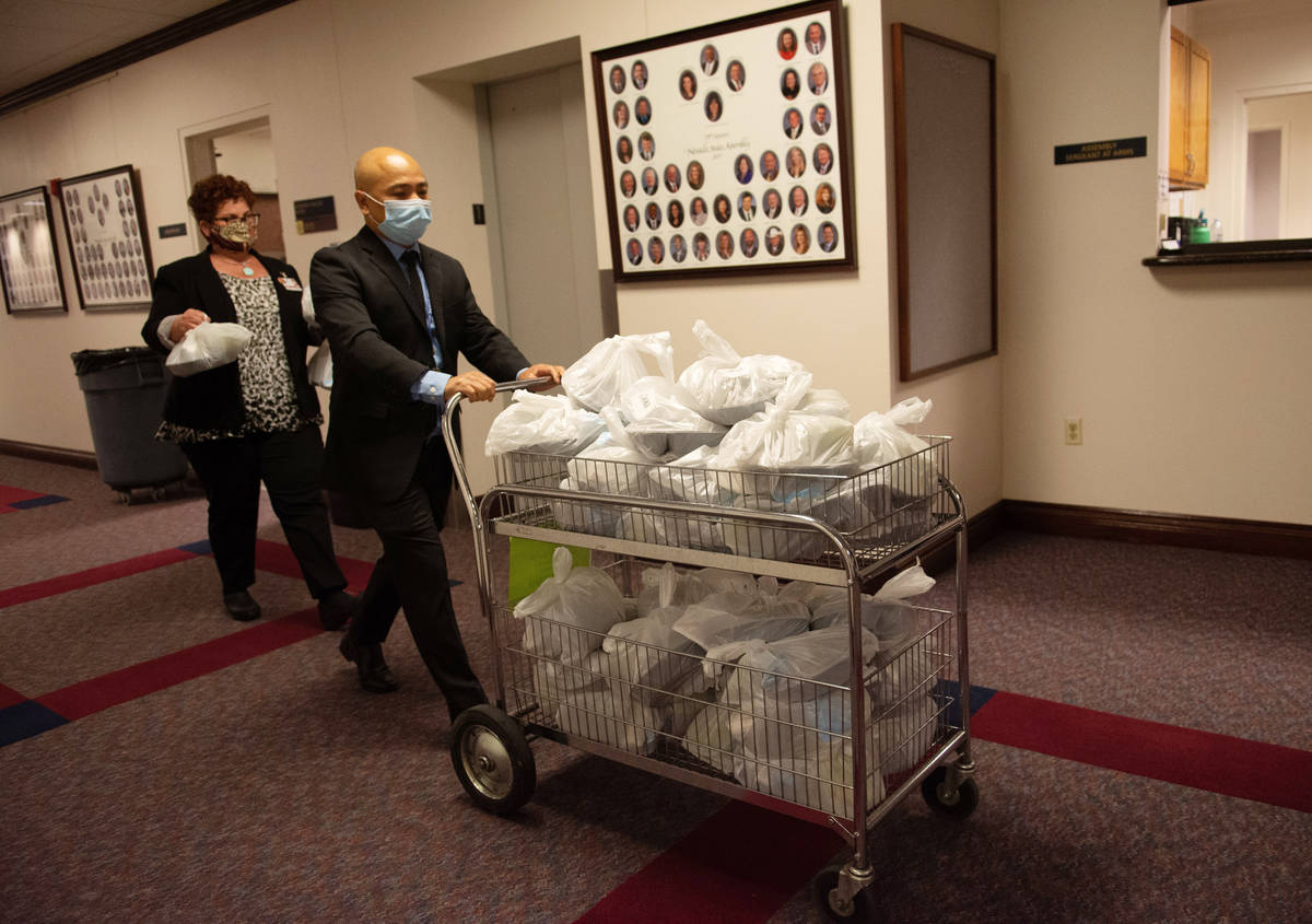 Assembly Sergeants at Arms bring lunch into he chambers on the second day of the 31st Special S ...