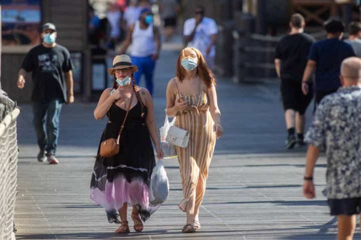 People walk on the Strip in Las Vegas on Friday, July 3, 2020. (Chris Day/Las Vegas Review-Journal)