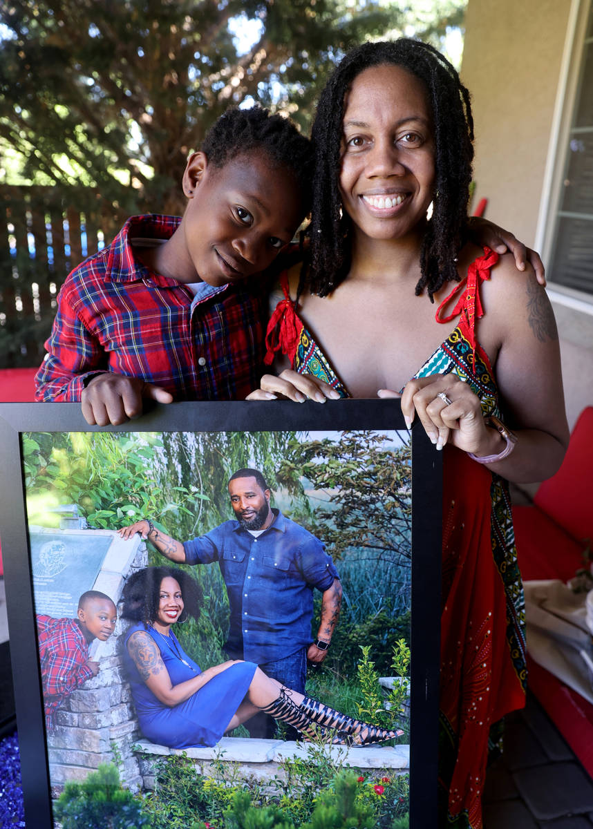 Alana Dixon-McAllister, 38, and her stepson, Bryce, 10, with a family photo including Dixon-McA ...