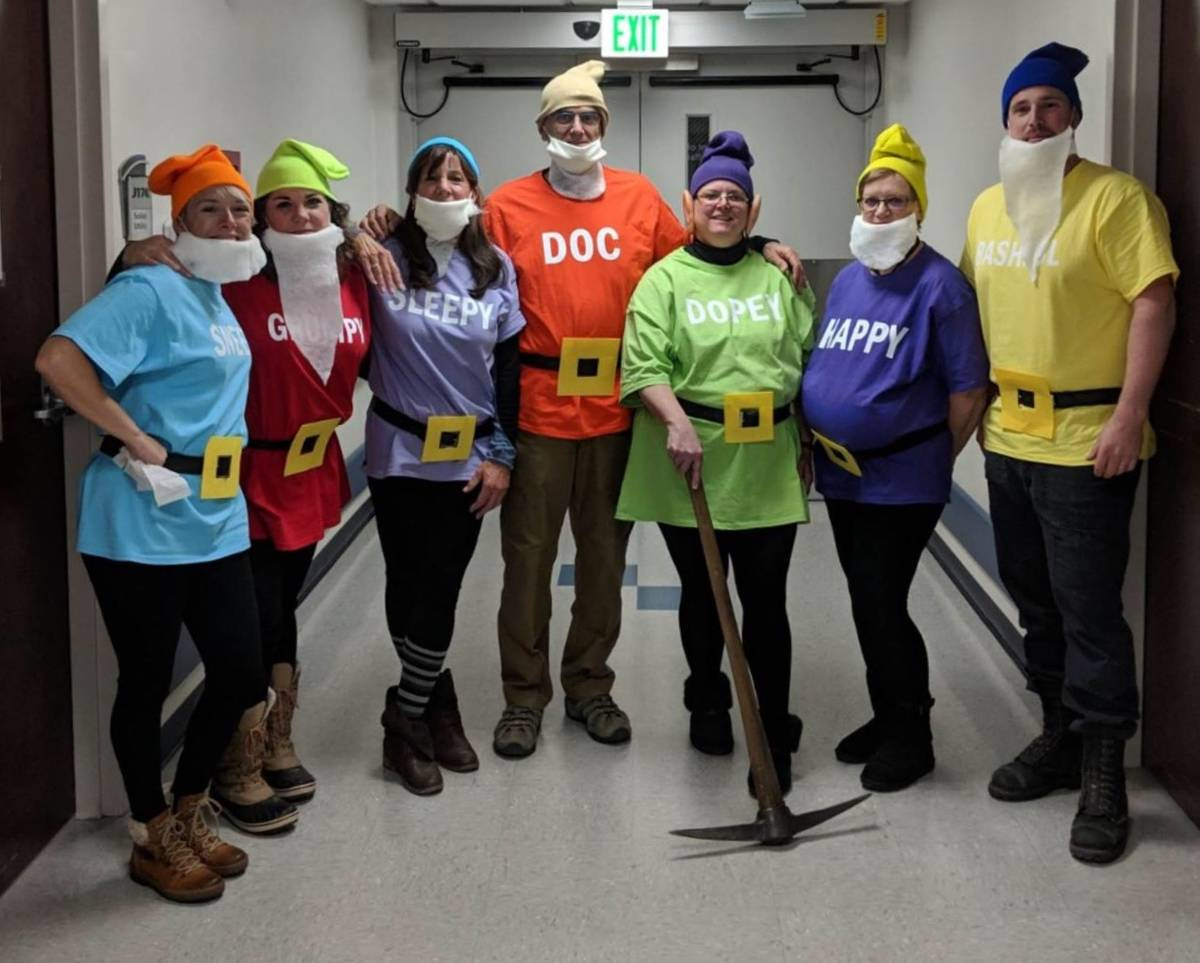 Vianna Thompson, 52, dressed as Dopey for Halloween 2019, with her coworkers. Thompson, an Army ...
