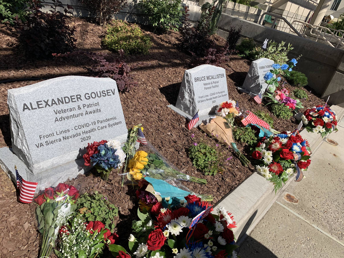 This photo shows the memorial markers for the three VA employees who died of COVID-19. The mark ...