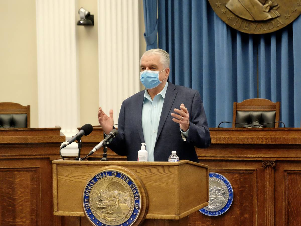 Gov. Steve Sisolak speaks to reporters Thursday in the state Capitol as he announces new restri ...