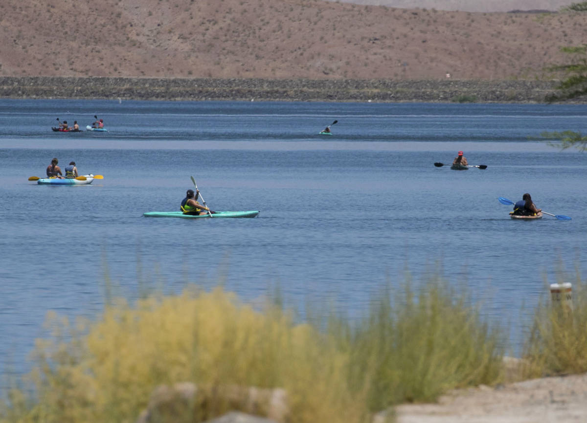 People enjoy paddle boarding at Lake Las Vegas on Monday, July 6, 2020, in Henderson. A dangero ...