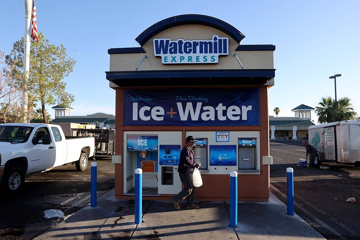 Pedro Hernandez gets ice for his work day at a kiosk on the corner of Smoke Ranch Road and Jone ...
