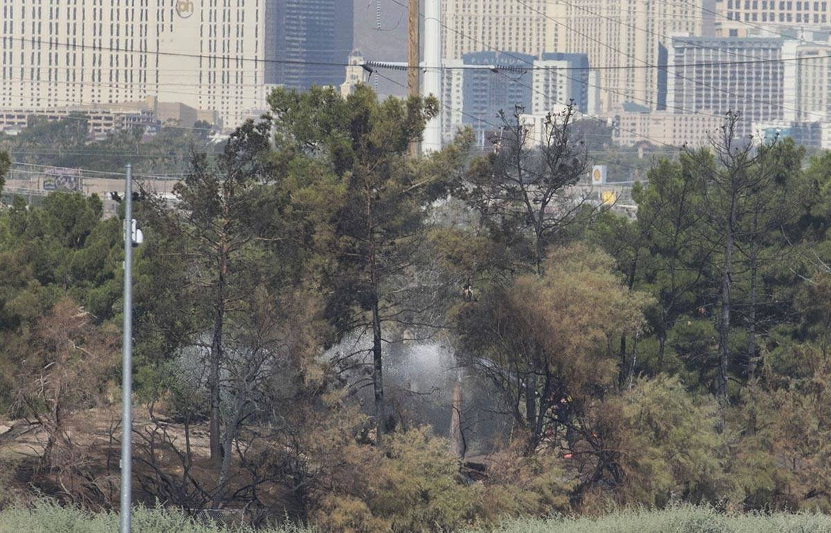 Clark County firefighters were called to a brush fire in east Las Vegas near Royal Links Golf C ...