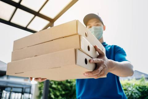 Third-party food delivery services vary in their policies about the face-covering mandate in Ne ...