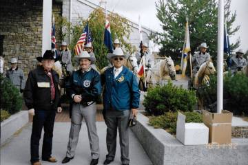 John H. Robinson, left, pictured in front of a ceremonial posse during a Nevada Day Parade in t ...