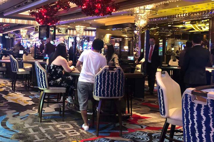 Gamblers sit three to a table at the Cosmopolitan of Las Vegas on Thursday, June 4, 2020. (Bria ...