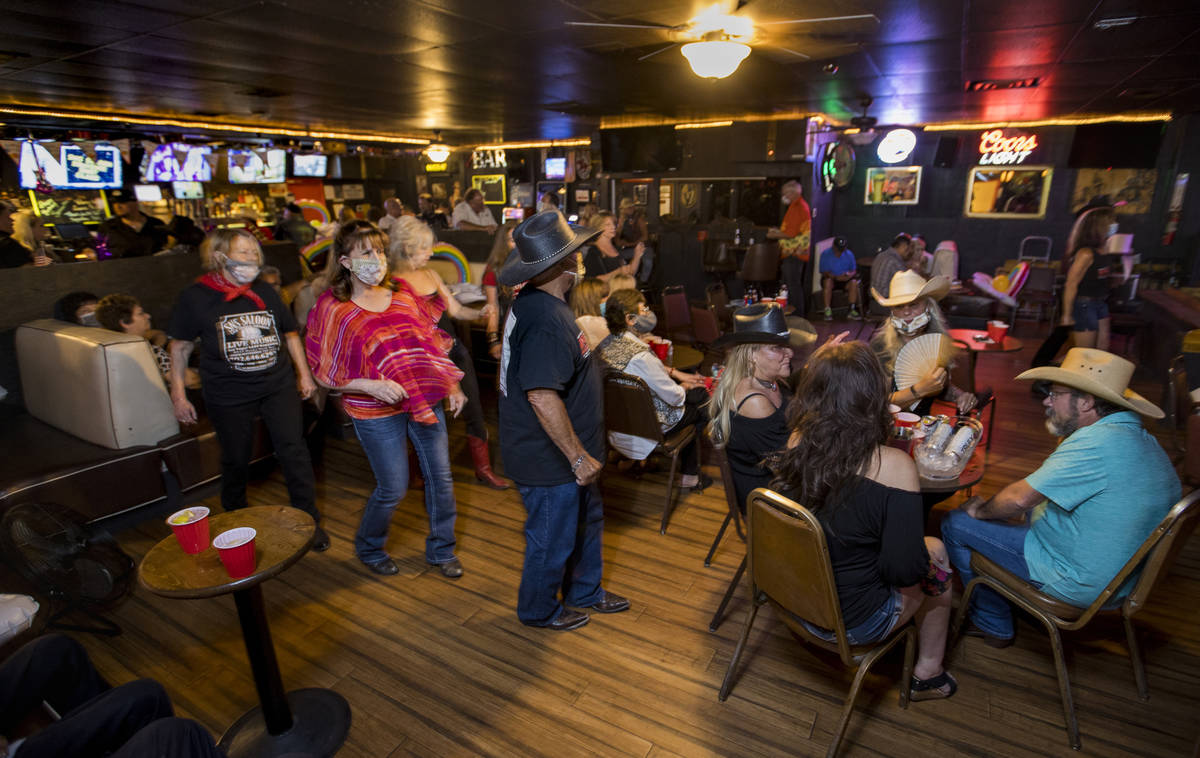 Dancers take to the floor amongst other patrons as owner Bobby Kingston plays with his band on ...