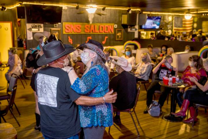 Teddy, left, and Brenda Valdez with Lone Wolf Dancing take to the floor as owner Bobby Kingston ...