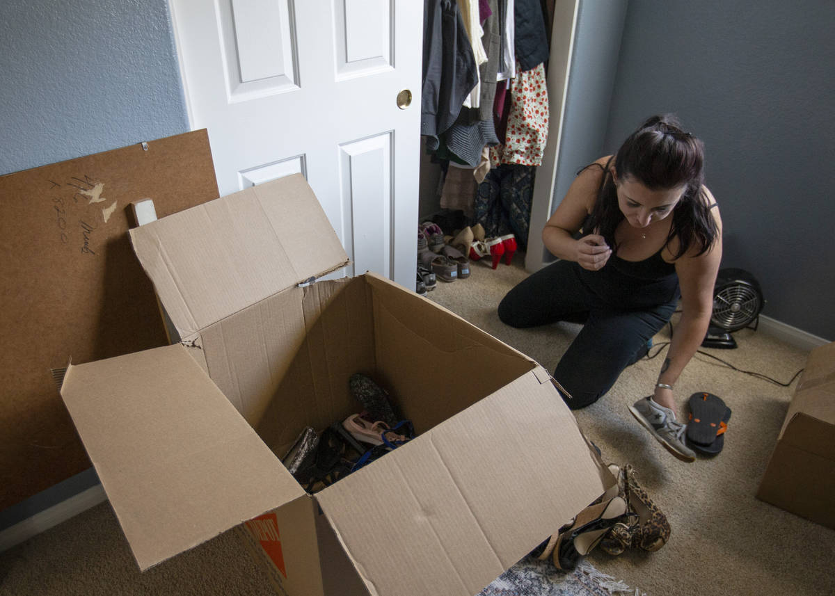Alexis Cossman unpacks her last box as she moves into her roommate's newly purchased home on We ...