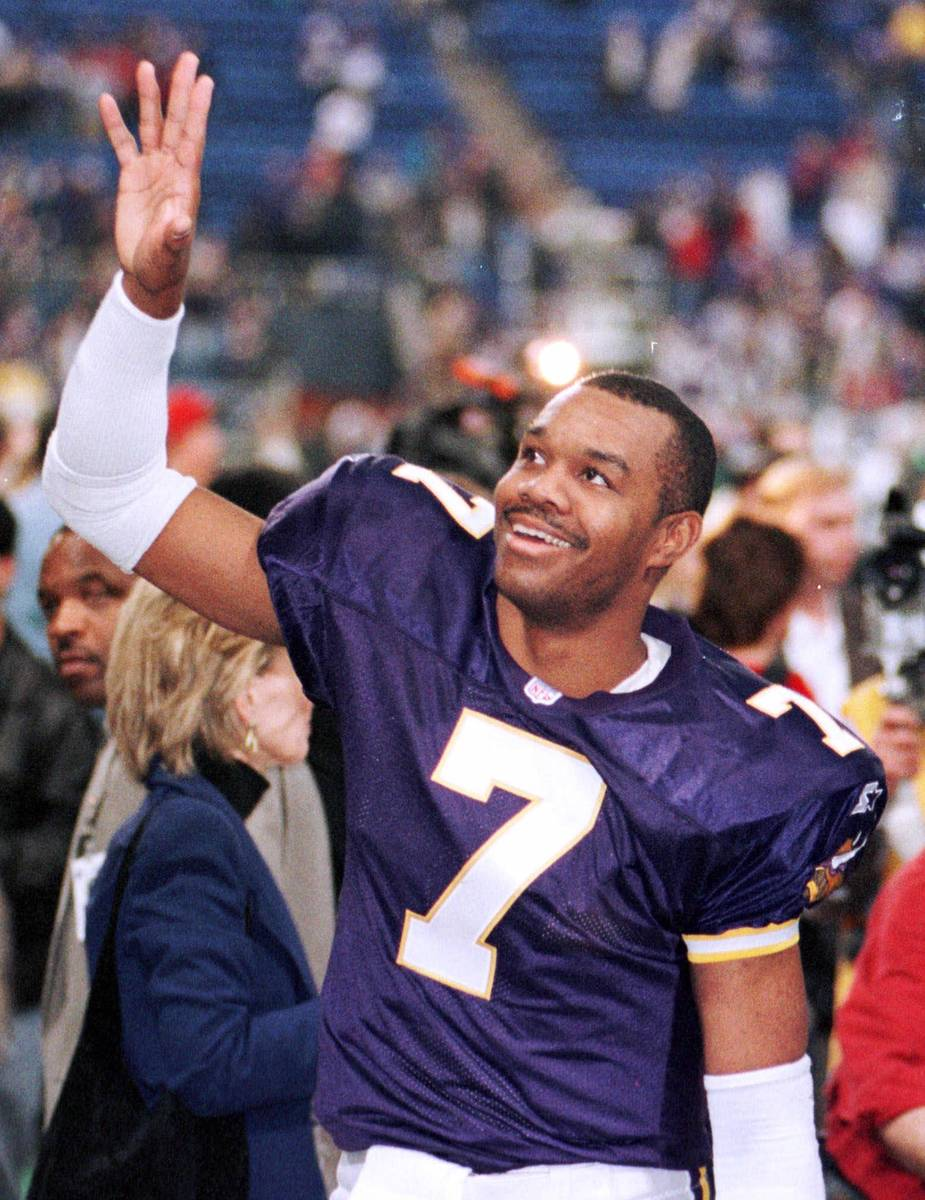 Minnesota Vikings quarterback Randall Cunningham waves to someone in the crowd after their 41-2 ...