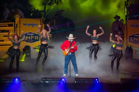 Charlie Daniels performs for the fans during the start of the fourth go round of the Wrangler N ...