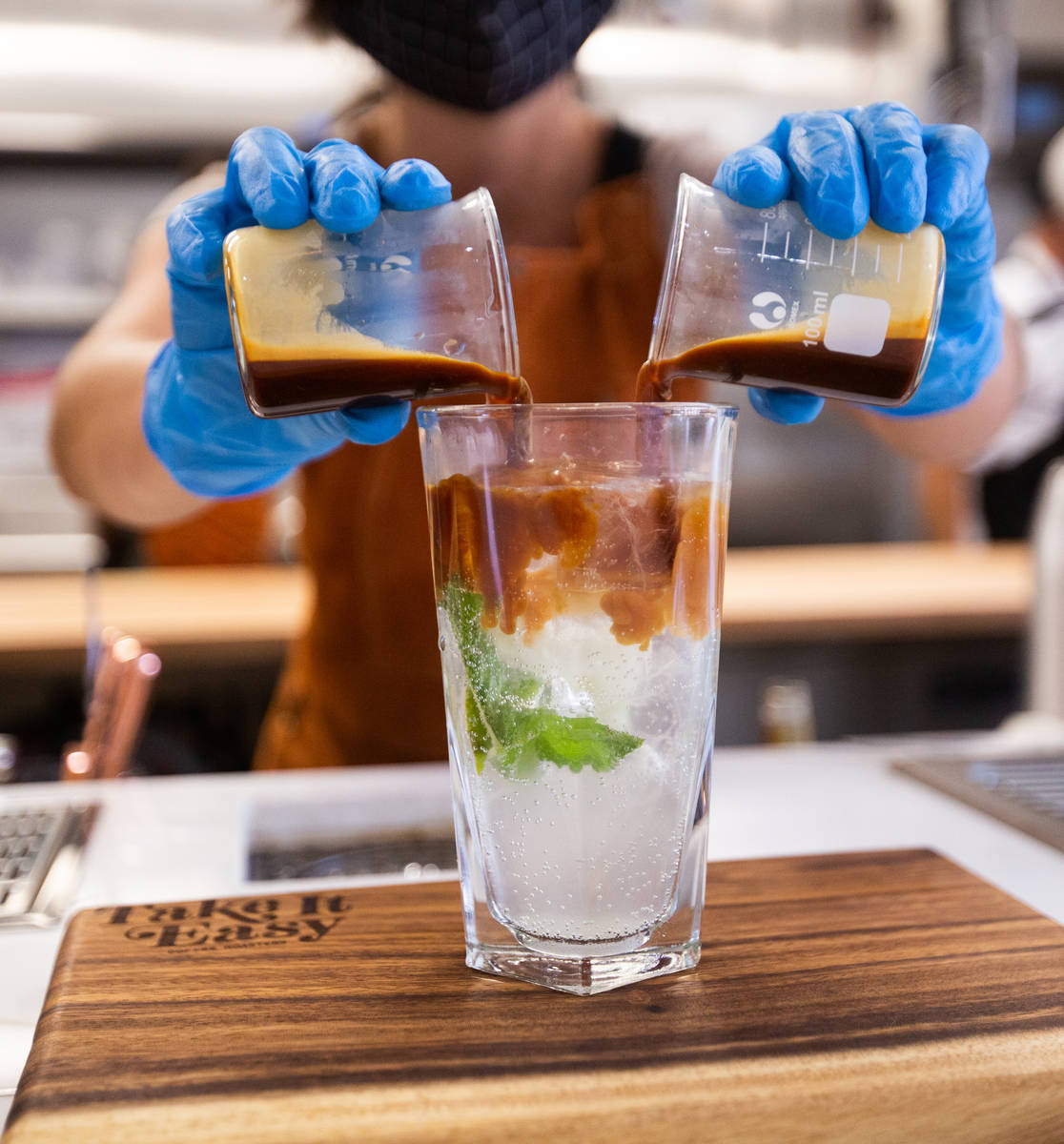Quianna Rodriguez, a barista at Take It Easy, prepares the drink Somewhere in Kentucky in Las V ...