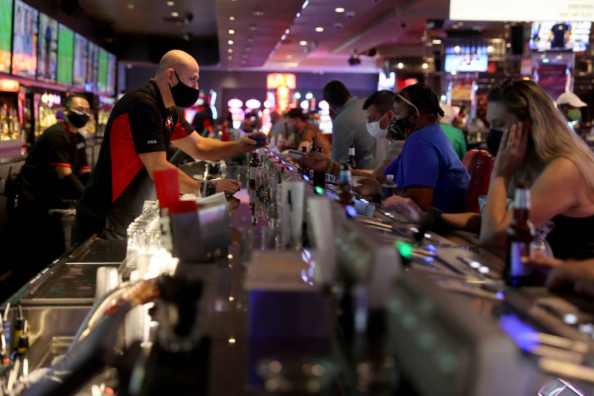 Steve, who declined to give his last name, serves drinks at Longbar at D Las Vegas Friday, July ...