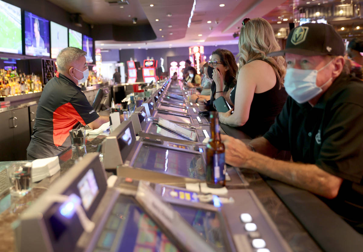 Ted Fager of Henderson, right, drinks at D Las Vegas, Friday, July 10, 2020, as Rosa Reyes, lef ...