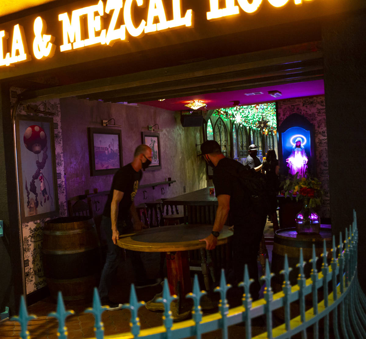 Employees move a table as they shut down at Lucky Day Tequila and & Mezcal House on Fremont ...