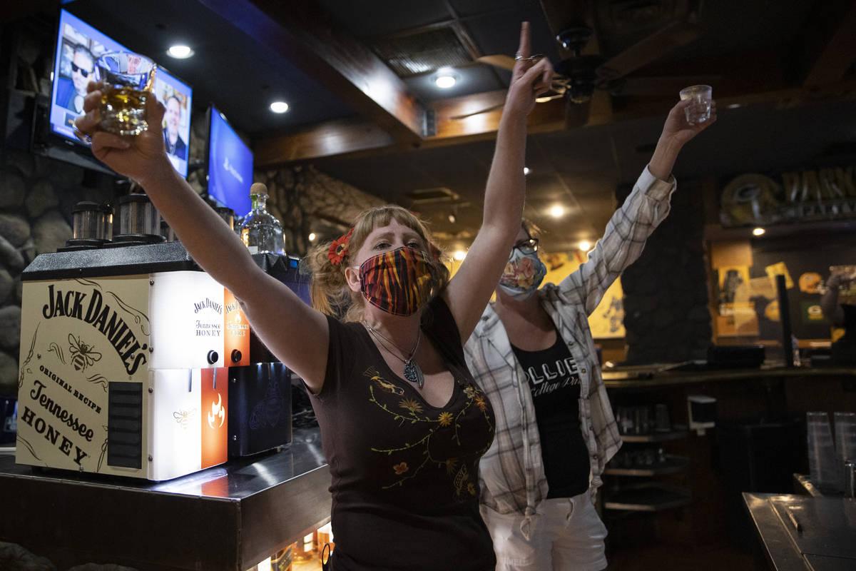Bartenders Teah Heath, left, and Dawn Smith announce last call at Jackson's Bar & Grill on Frid ...