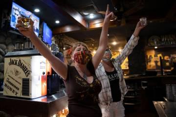 Bartenders Teah Heath, left, and Dawn Smith announce last call at Jackson's Bar & Grill on Fr ...