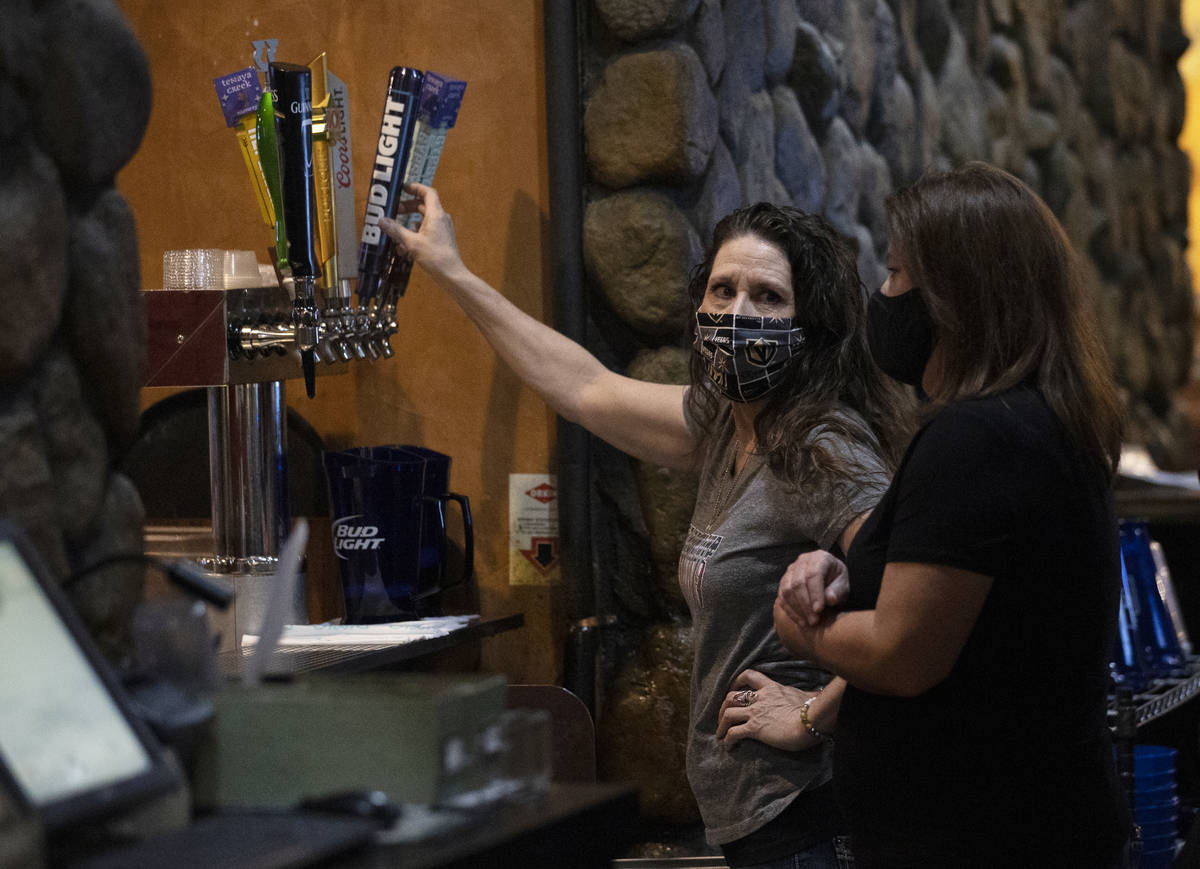 Audrey McCartney, left, pours a pitcher of beer at Jackson's Bar & Grill on Friday, ...