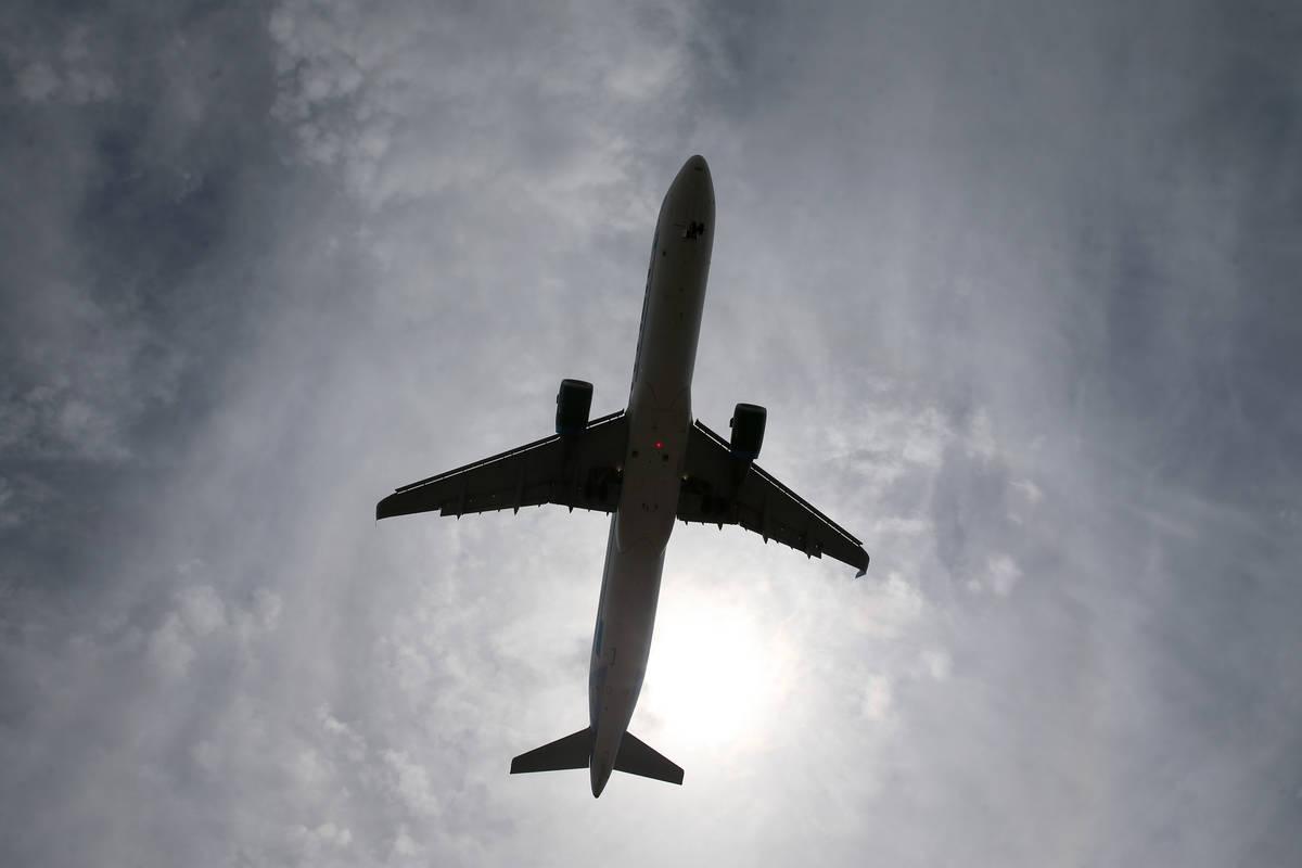 A plane arrives to McCarran International Airport in Las Vegas, Saturday, July 11, 2020. (Erik ...