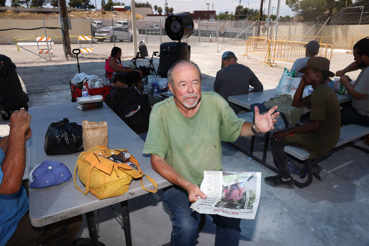 James Stamper reads thew newspaper under the shade at the Courtyard Homeless Resource Center co ...