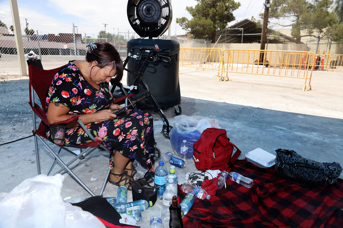 Elizabeth Lazio plays a Nintendo game at the Courtyard Homeless Resource Center cooling station ...