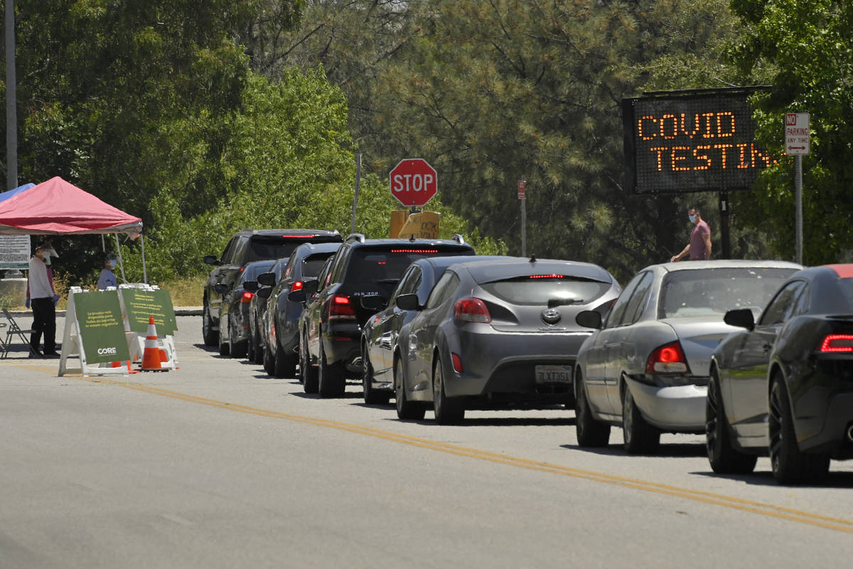 FILE - Cars line up for coronavirus testing at Hansen Dam Recreation Center, Tuesday, July 7, 2 ...