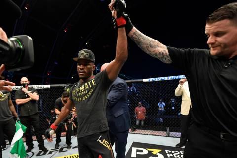 Kamaru Usman of Nigeria celebrates after his victory Saturday over Jorge Masvidal in their UFC ...