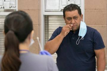 Alondra Contreras, left, a register nurse from Southern Nevada Health District, watches as Jose ...
