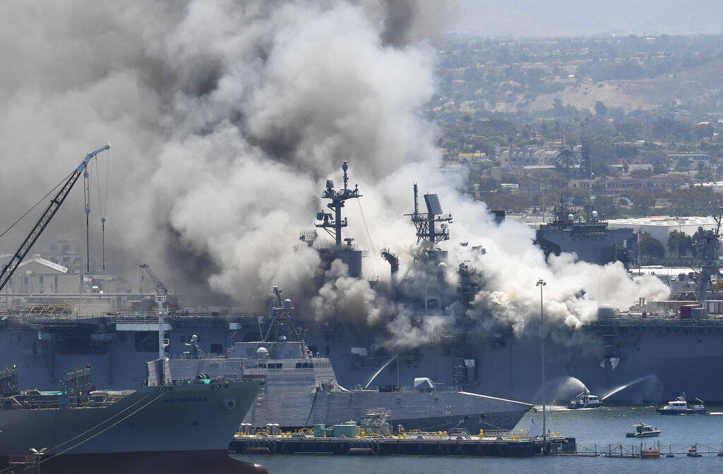 Smoke rises from the USS Bonhomme Richard at Naval Base San Diego Sunday, July 12, 2020, in San ...