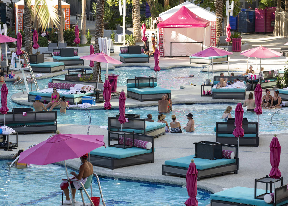 Guests cool off from the 113-degree heat at Flamingo Las Vegas on Sunday, July 12, 2020, on the ...