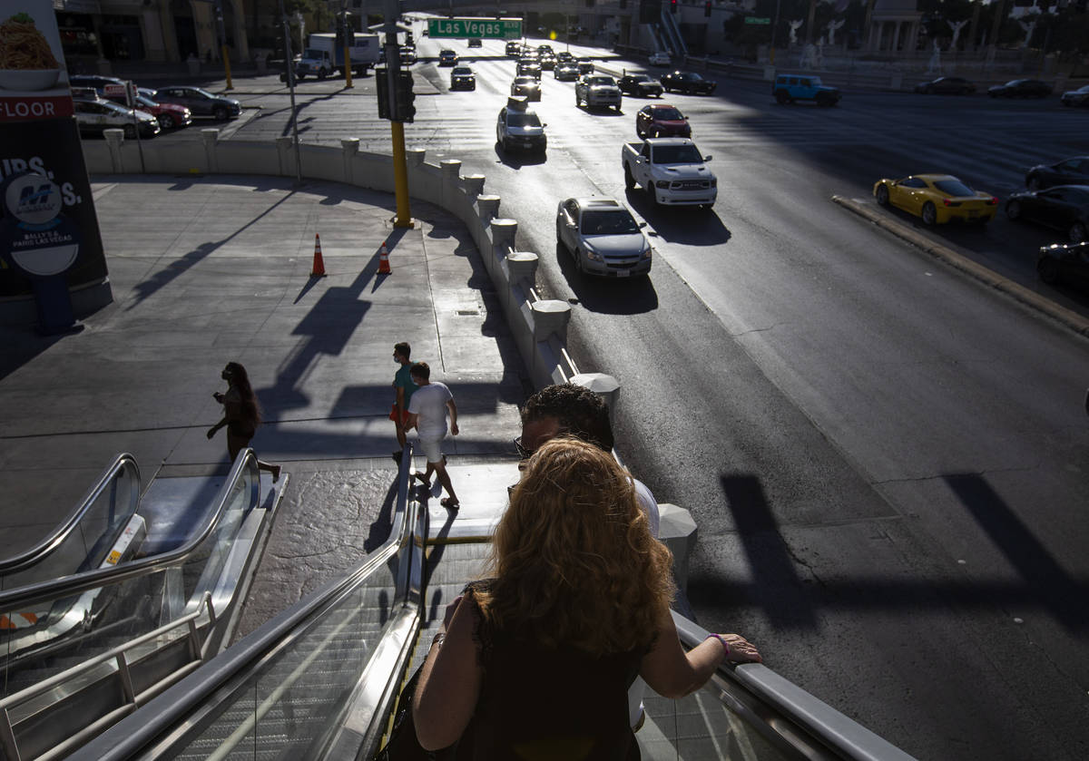 The sun beats down on pedestrians as temperatures reached 113 degrees on Sunday, July 12, 2020, ...