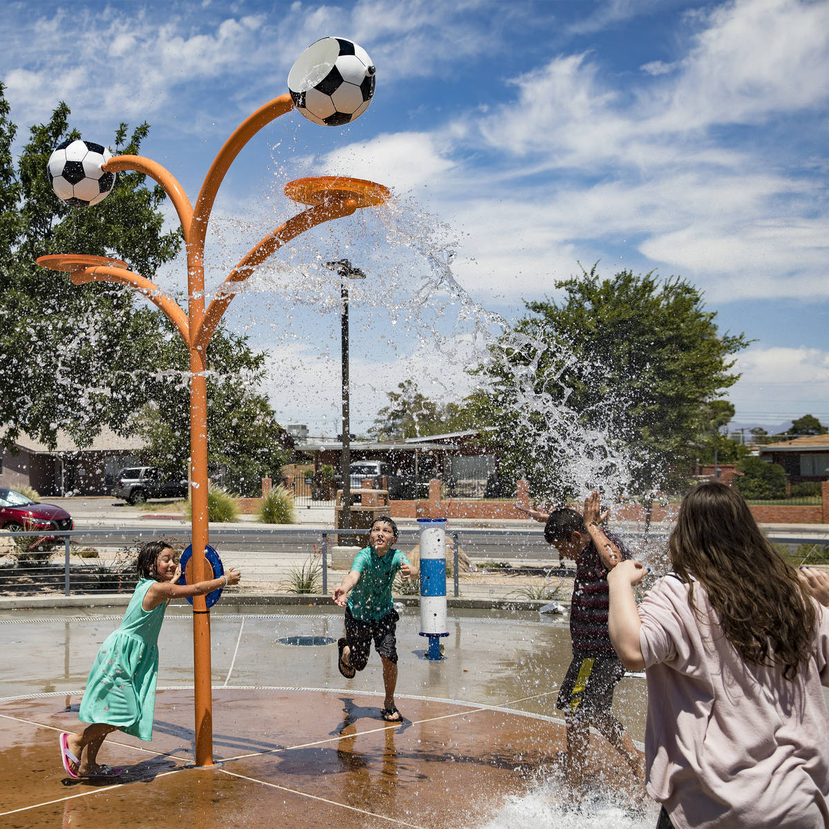Myriah Vernoy, 8, from left, plays with her brother Josiah Vernoy, 12, center, at Baker Park in ...