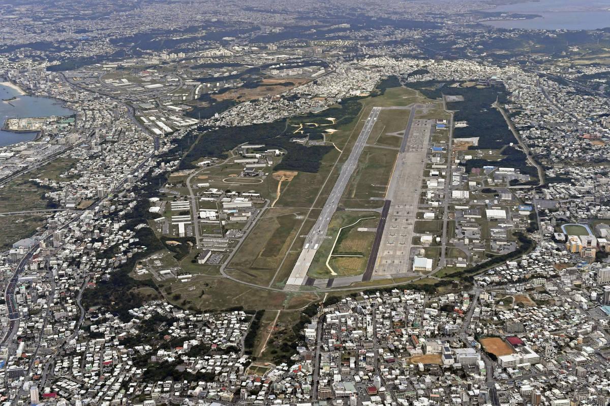 FILE - This Jan. 27, 2018, aerial file photo shows U.S. Marine Air Station Futenma in Ginowan, ...