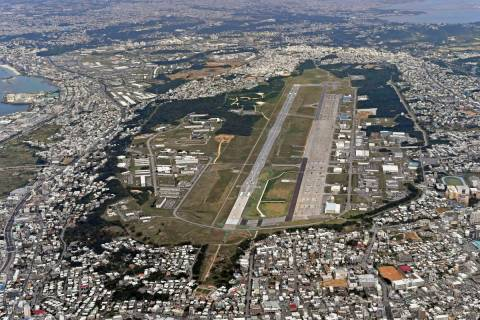 FILE - This Jan. 27, 2018, aerial file photo shows U.S. Marine Air Station Futenma in Ginowan, ...
