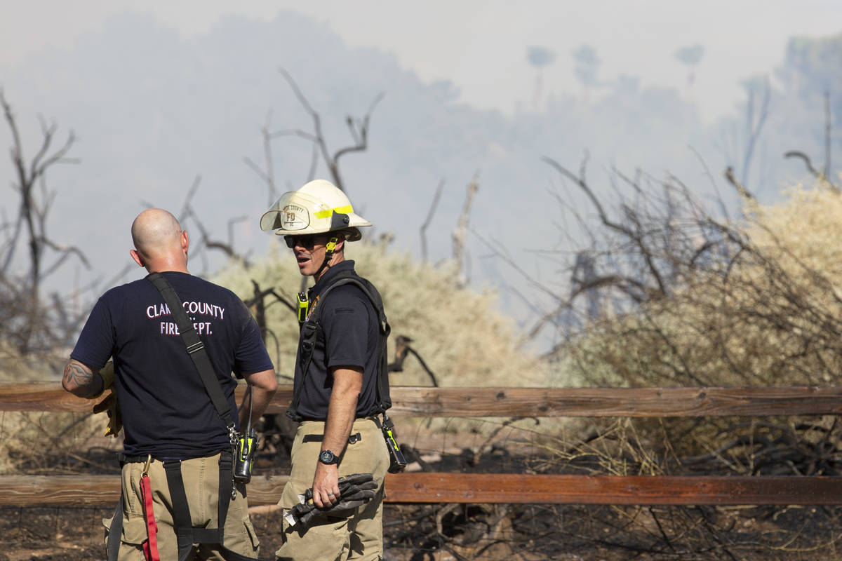 Clark County and Henderson Fire Departments respond to an outside fire on South Pecos Road next ...