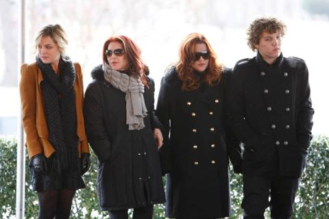 FILE - In this Jan. 8, 2010, file photo, Priscilla Presley, second from left, her daughter, Lis ...