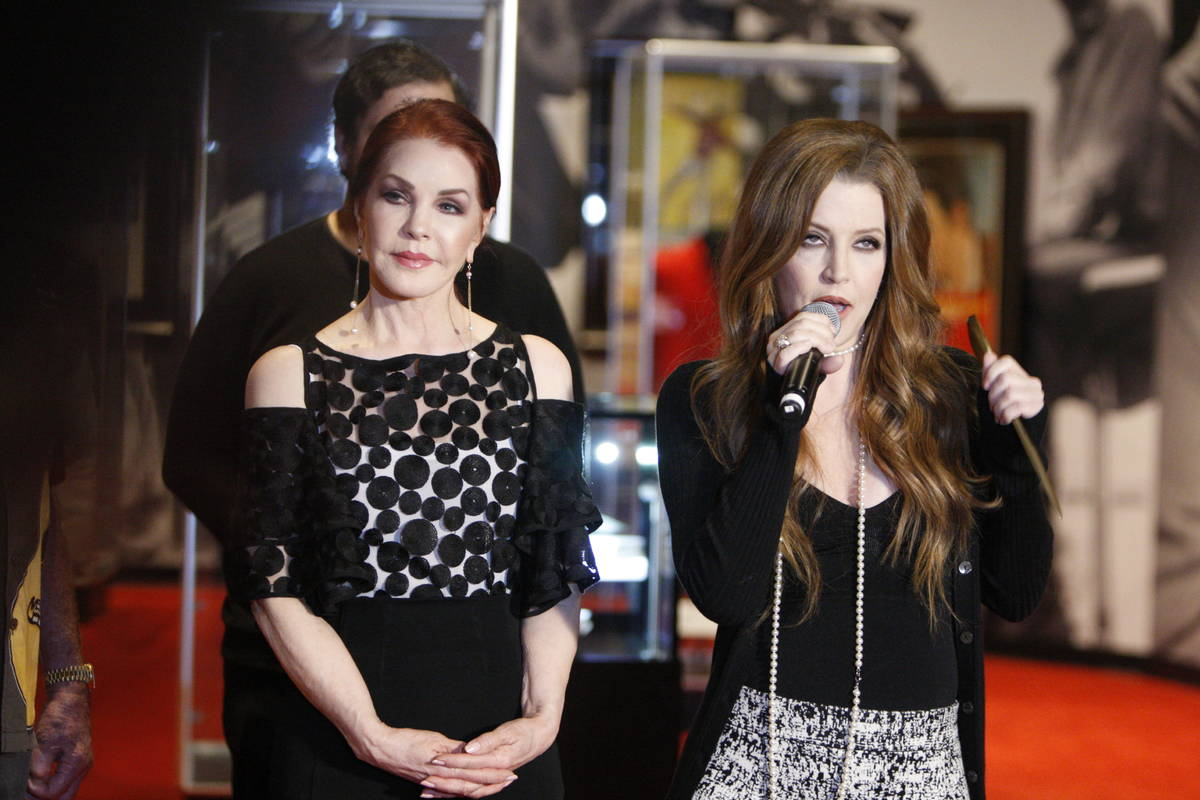 Priscilla Presley, left, listens to her daughter Lisa Marie Presley speak during a media day fo ...