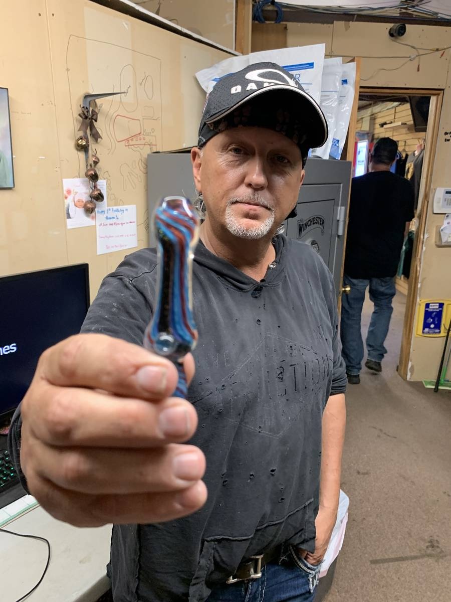 Jeff Lowe is shown with Travis Maldonado's glass pipe at Greater Wynnewood Exotic Animal Park o ...