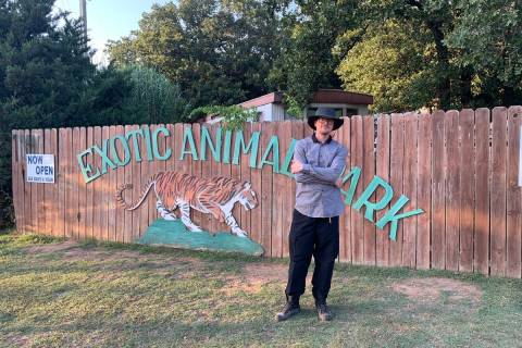 Zak Bagans is shown at the sign at the entrance Greater Wynnewood Exotic Animal Park on Saturda ...