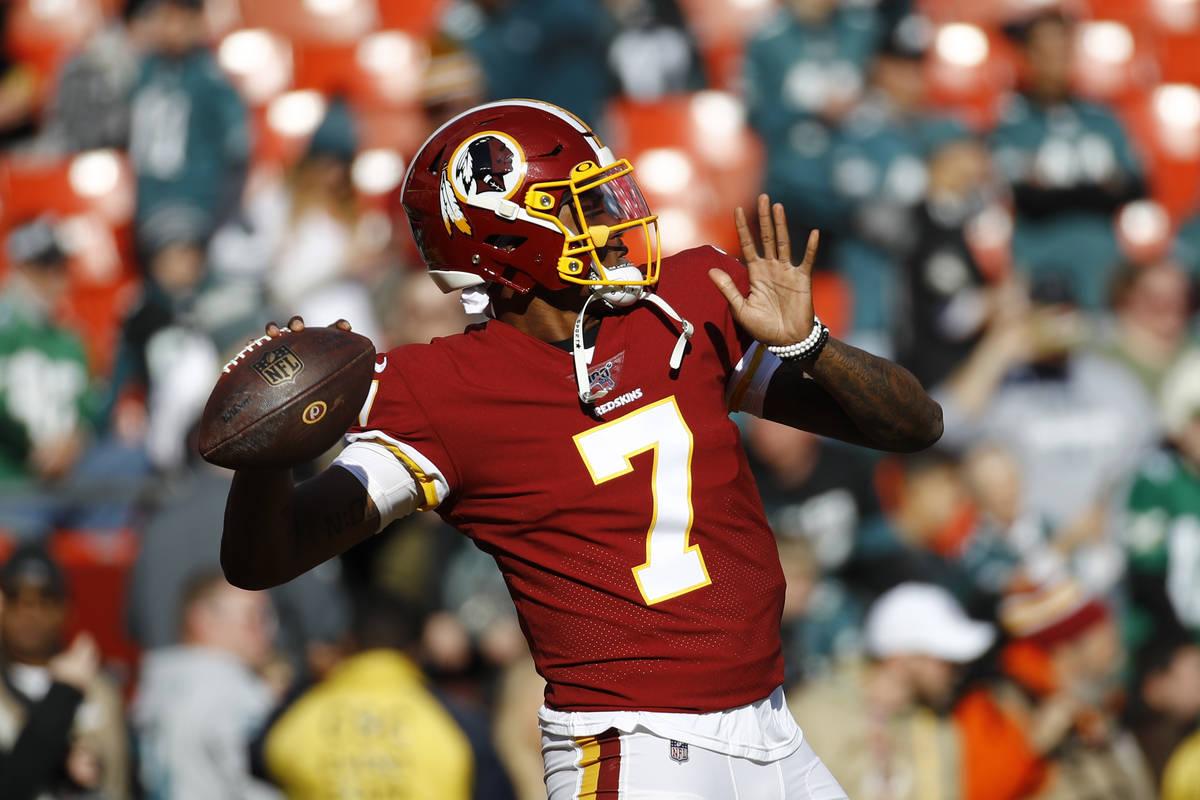 FILE - In this Dec. 15, 2019, file photo, Washington Redskins quarterback Dwayne Haskins warms ...