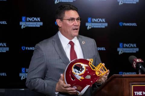 In a Jan. 2, 2020, file photo, Washington Redskins head coach Ron Rivera holds up a helmet duri ...