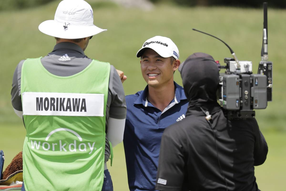 Collin Morikawa smiles after winning the Workday Charity Open golf tournament on the third play ...