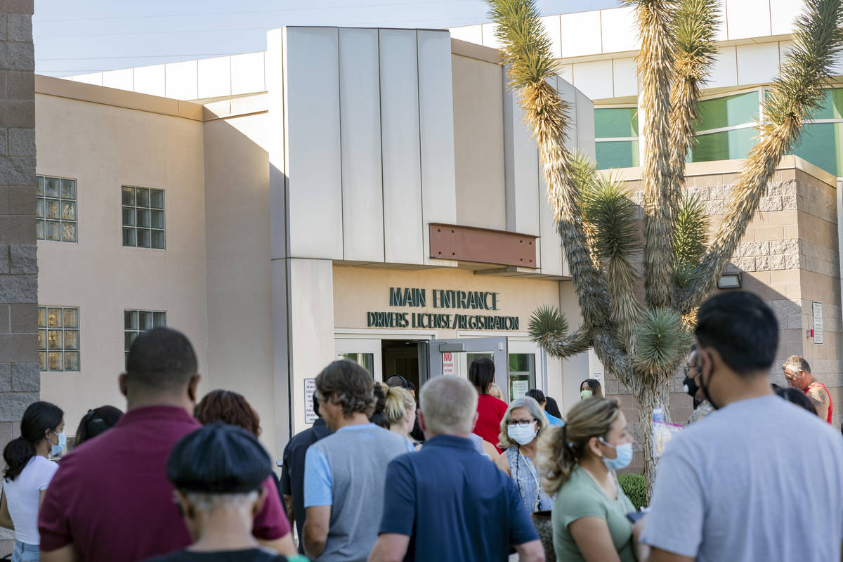 People wait in line at the Nevada Department of Motor Vehicles at 8250 West Flamingo Road, Las ...