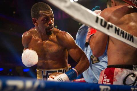Jamel Herring keeps Juan Pablo Sanchez on the ropes during their lightweight boxing bout Saturd ...